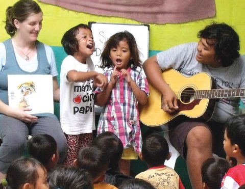 teaching classmates a song in southeast Asia